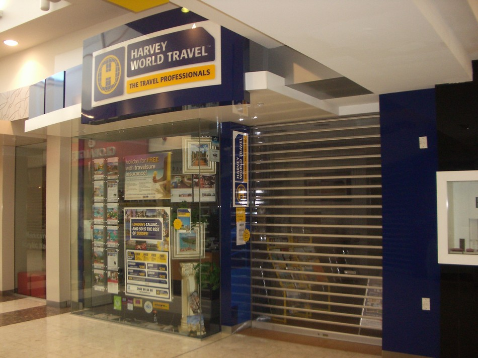 Branded Retail Store Frontage - Harvey World Travel