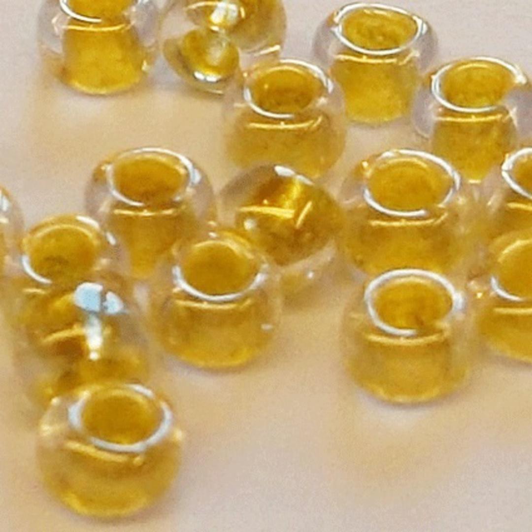 Toho size 8 round: 375H - Transparent, Golden Yellow colourlined image 1