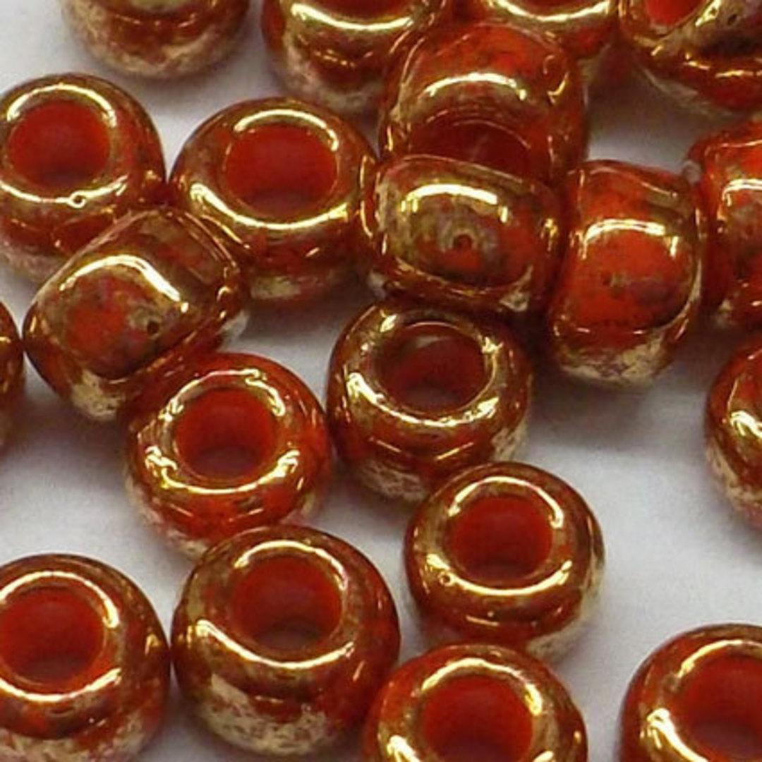 Toho size 8 round: 1707 - Red, bronze colourwash image 1
