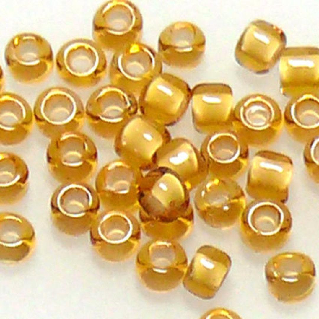 Matsuno size 11 round: 327E - Amber/White, colour lined image 0