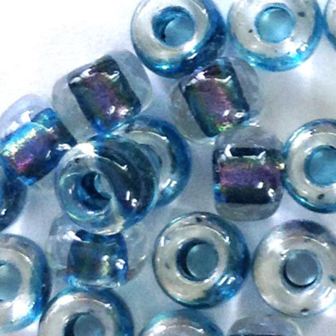 Miyuki size 6 round: 766 - Clear, lined with blue shimmer image 1