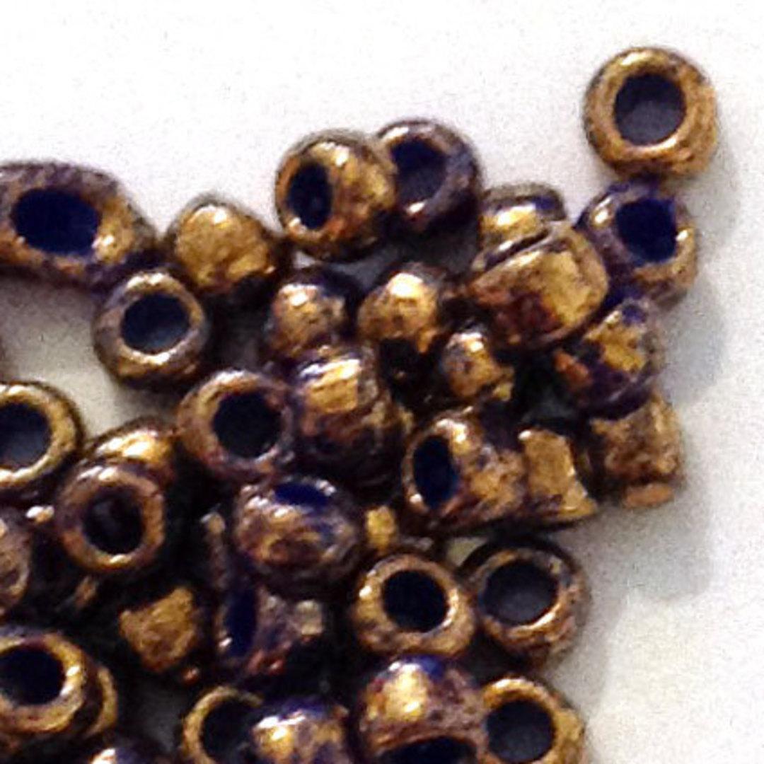 Toho size 8 round: 1701 - Rich Purple, bronze colourwash image 1
