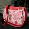 saddle style handbags