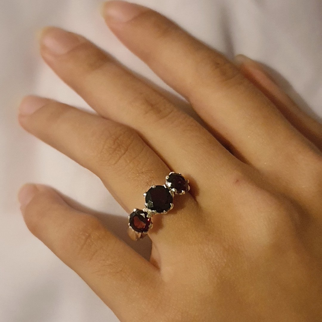 Silver ring with three sparkling red gemstones image 1