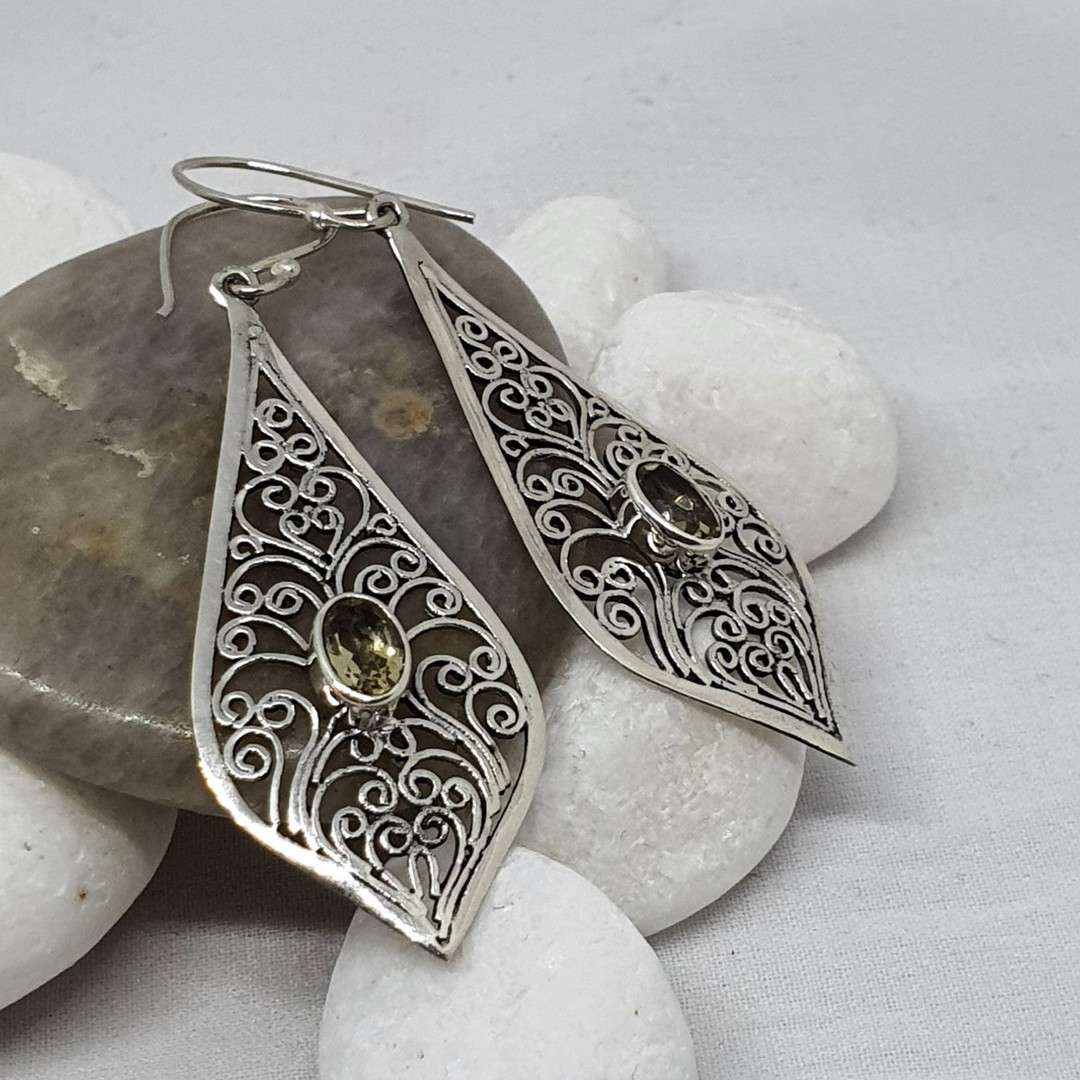 Silver filigree earrings with golden gemstone image 0
