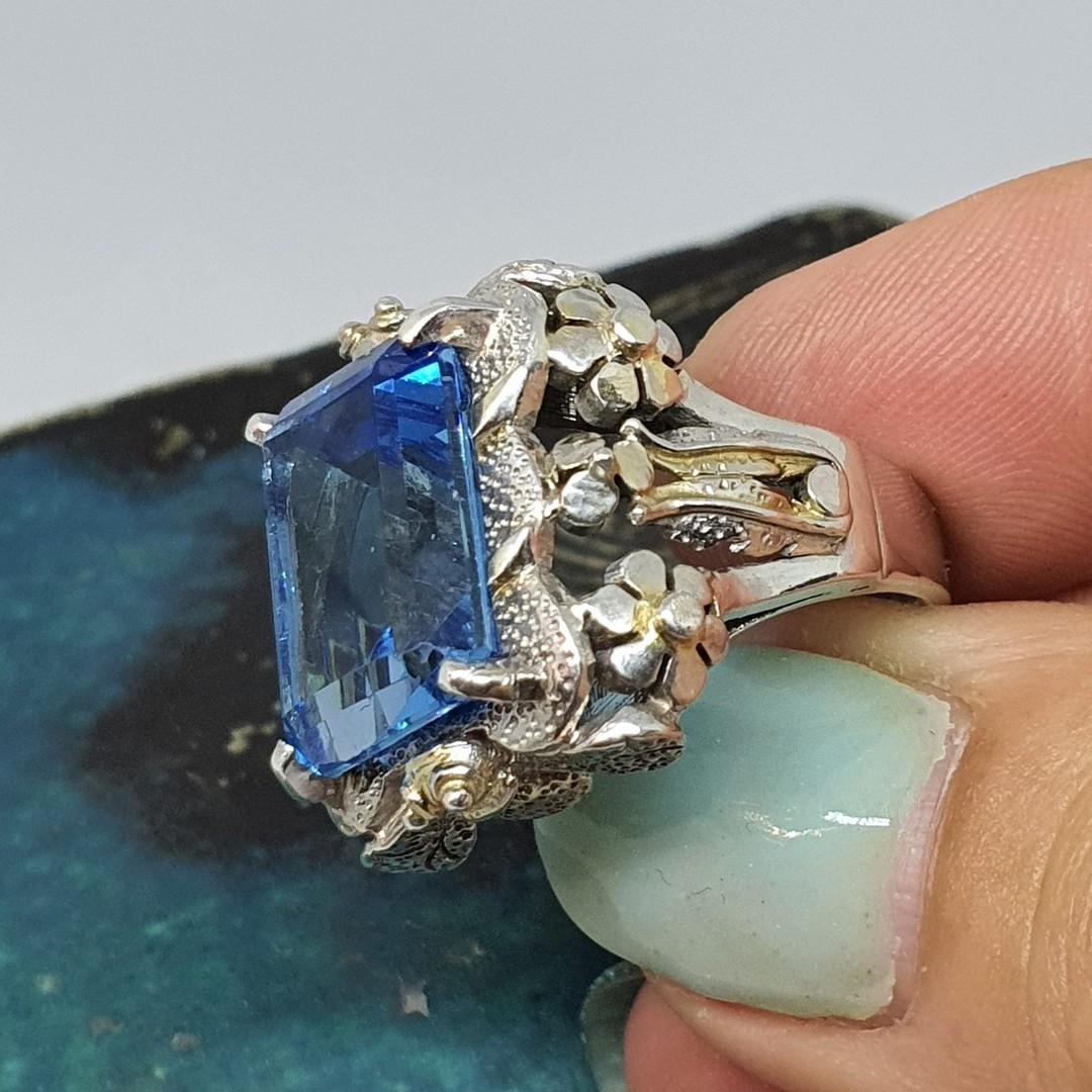 Large chunky silver ring with sparkling blue gemstone image 3