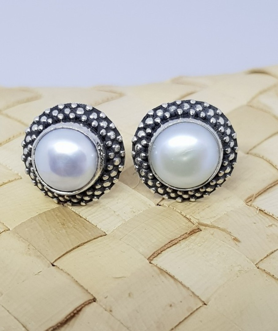White pearl stud earrings with decorated setting image 2