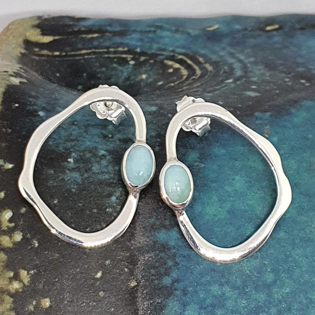 Open wonky oval shape larimar earrings image 0