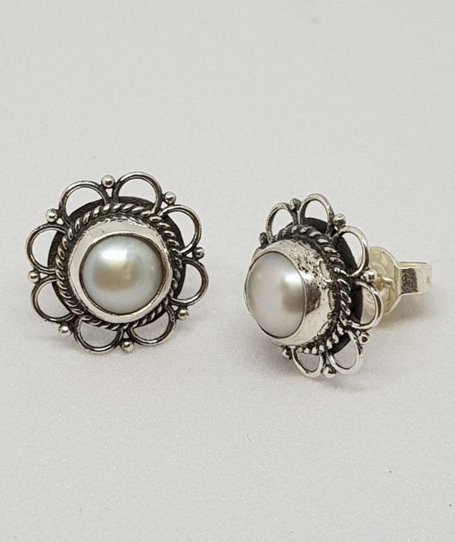 White pearl stud earrings with detailed silver frames image 2