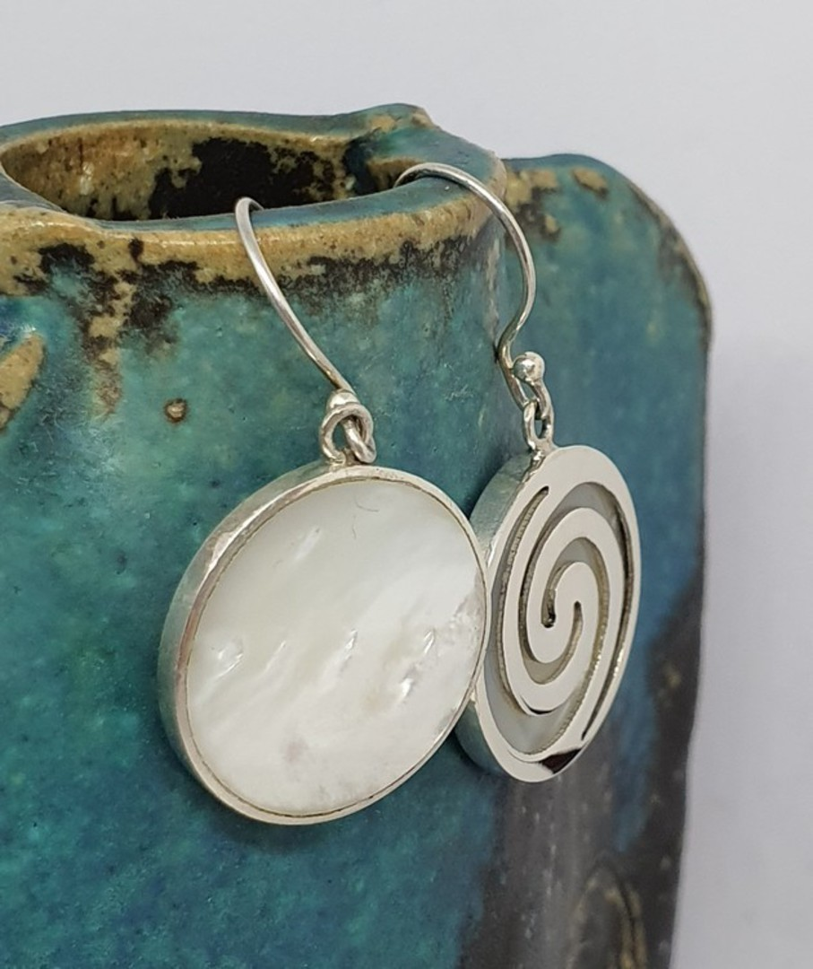 Round mother of pearl earrings overlaid with koru spirals image 2