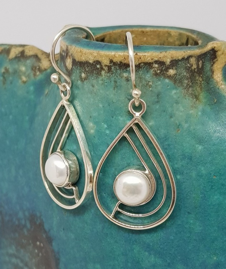 Teardrop white pearl earrings with open silver frame image 0
