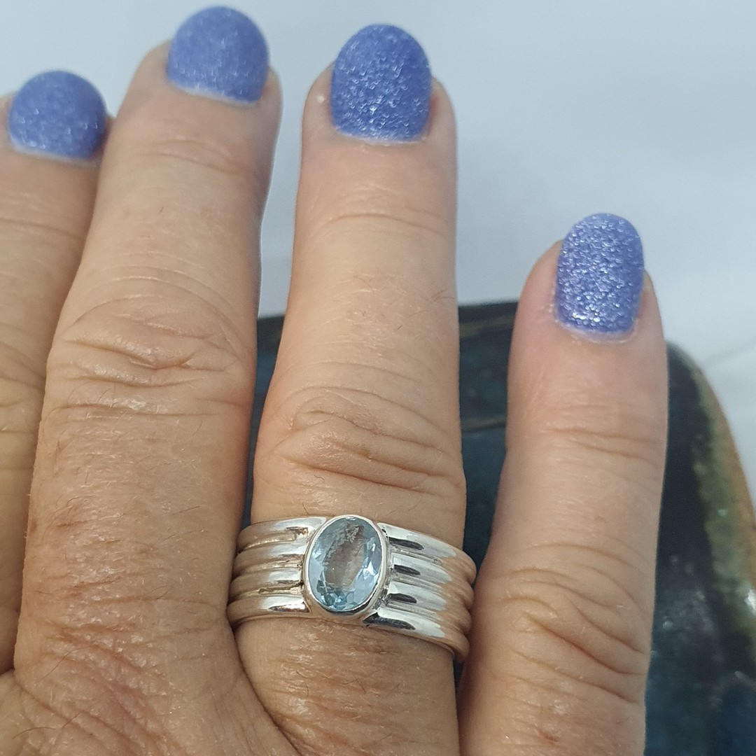 Sterling silver blue topaz ring image 1