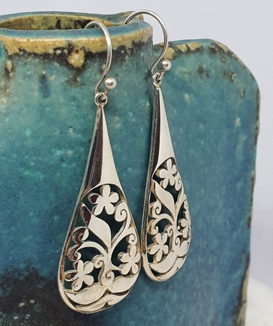 Sterling silver carved earrings image 0