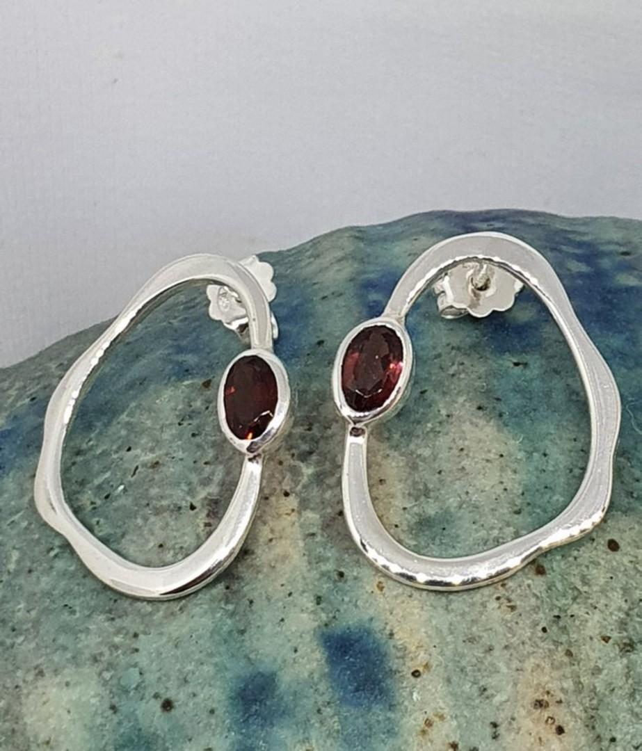 Open wonky oval shape garnet earrings image 0