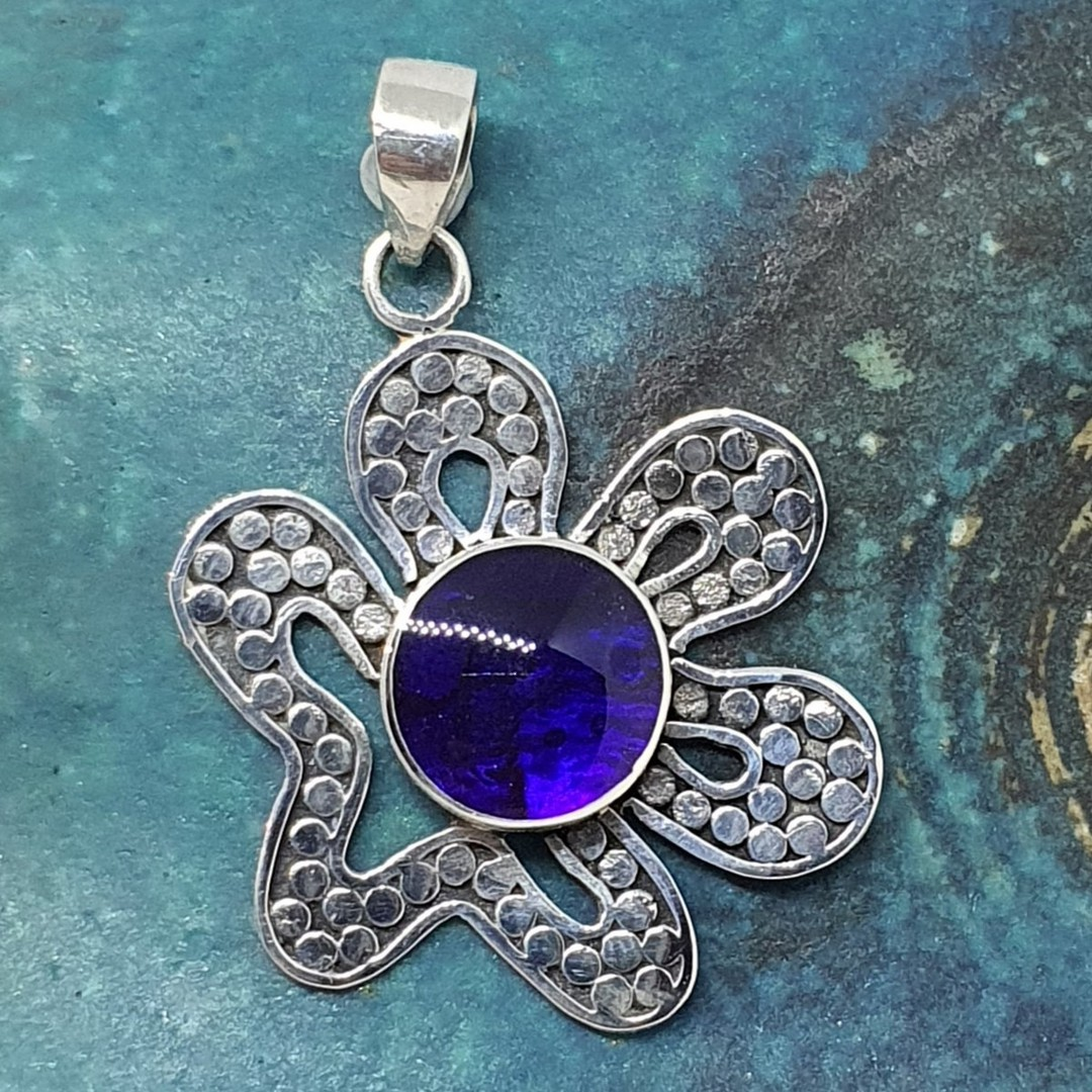 Pretty off centred flower pendant with purple gem image 0
