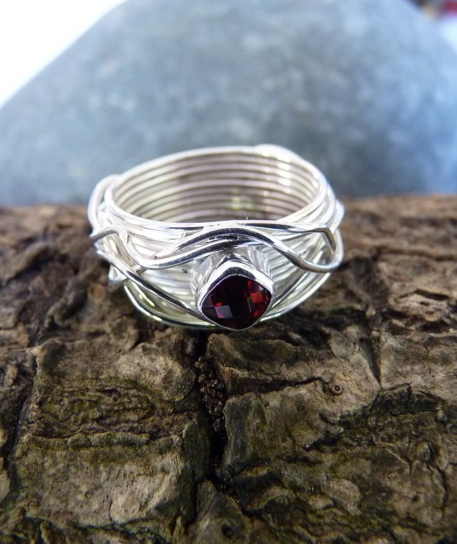 Wide silver band with sparkling garnet set in the top image 1