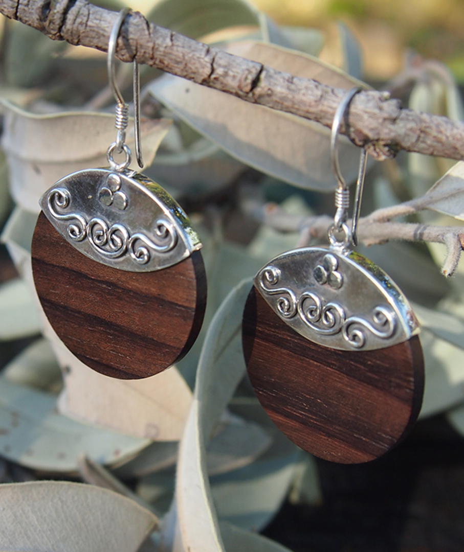 Polished wooden earrings with silver hook image 0