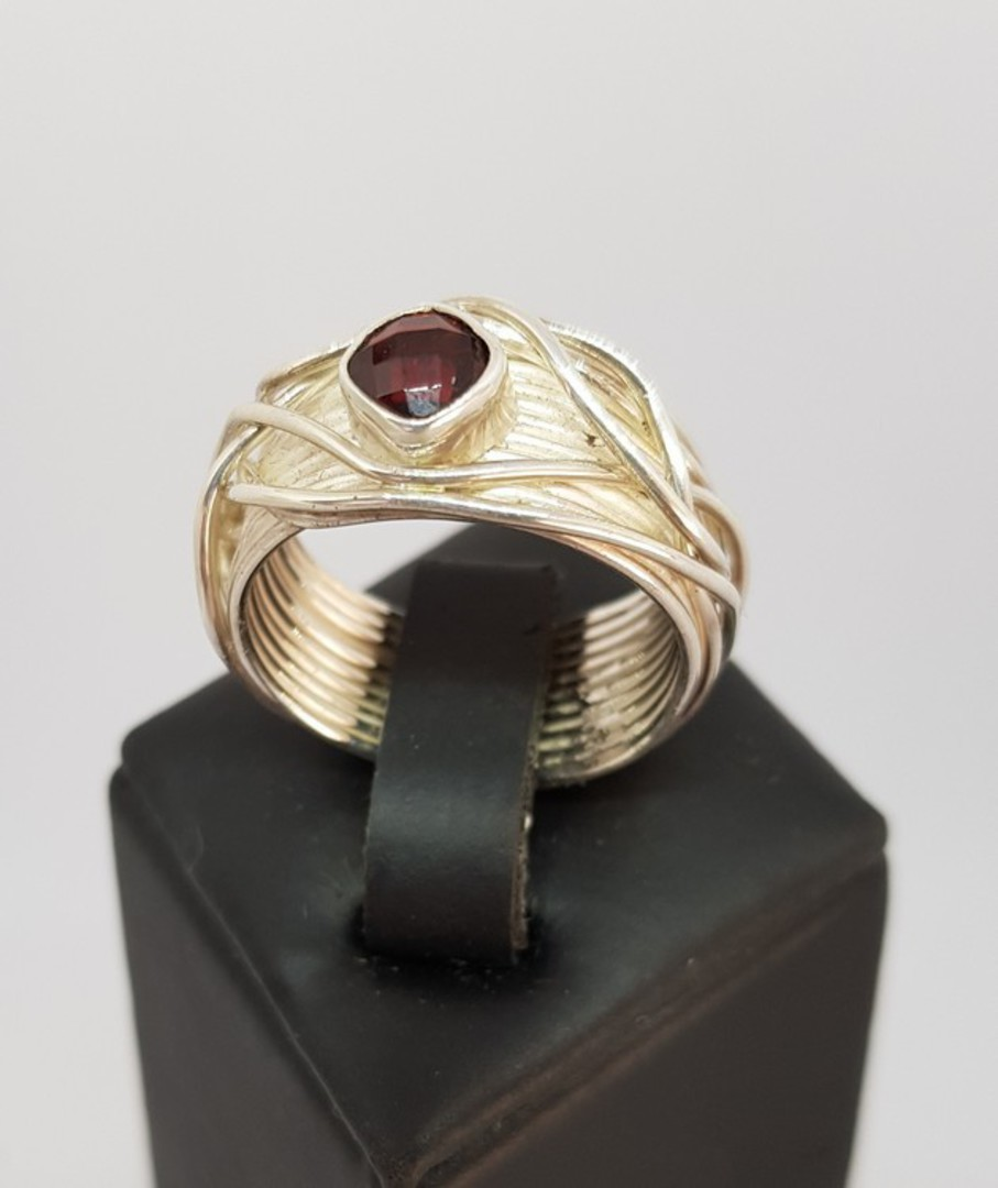 Wide silver band with sparkling garnet set in the top image 0