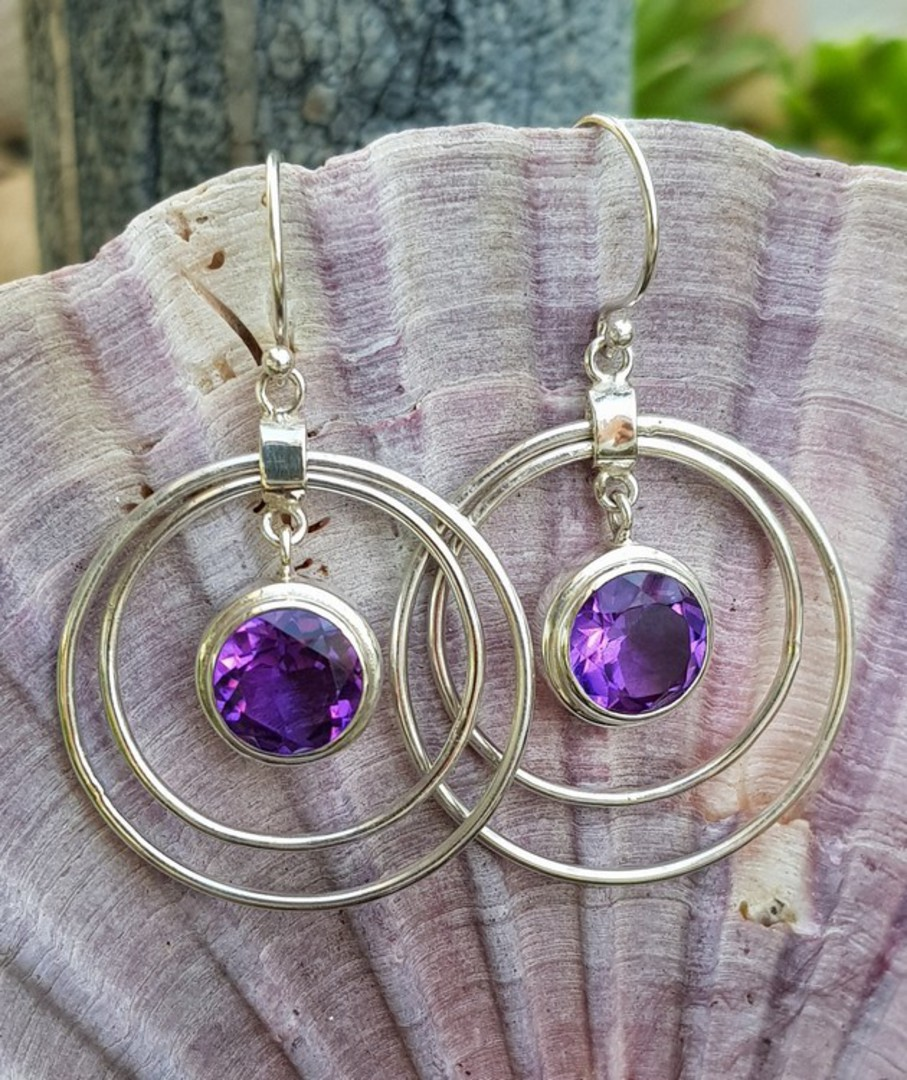 Silver hoop earrings with purple gemstone image 1