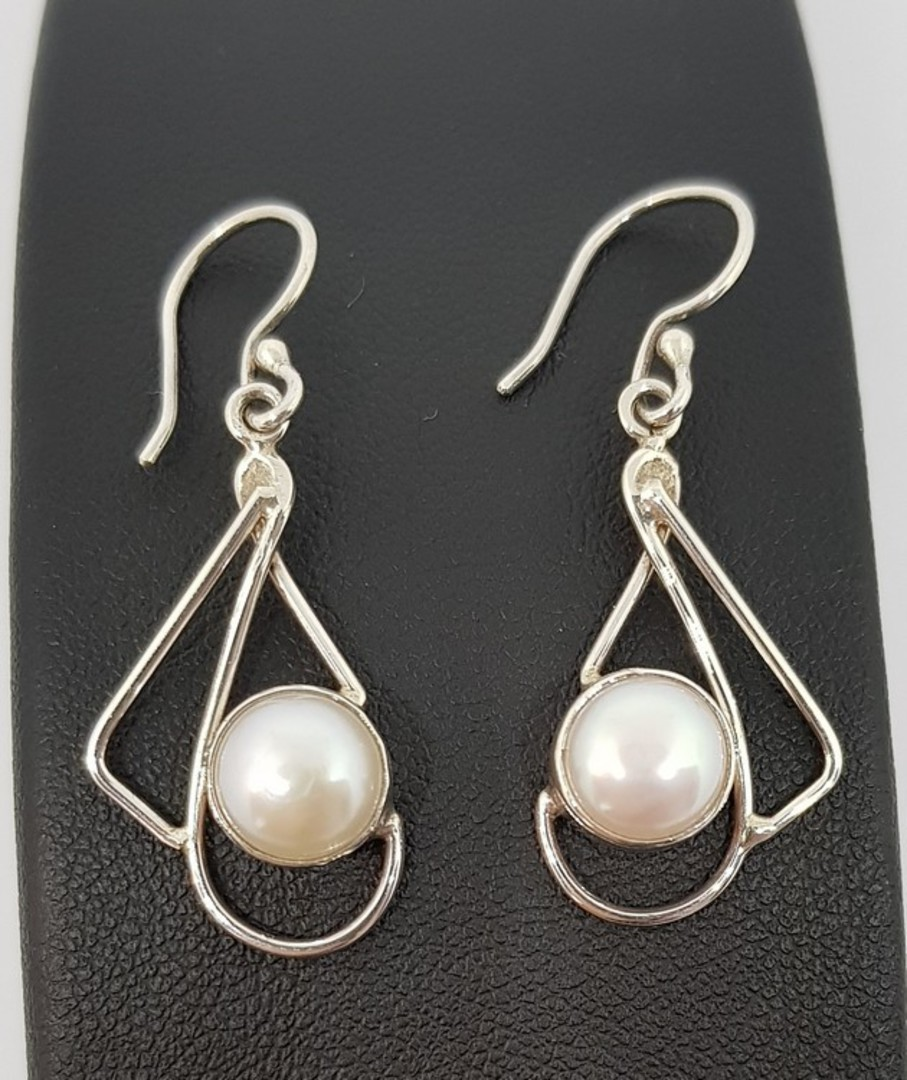 Silver pearl earrings with open silver frame image 1