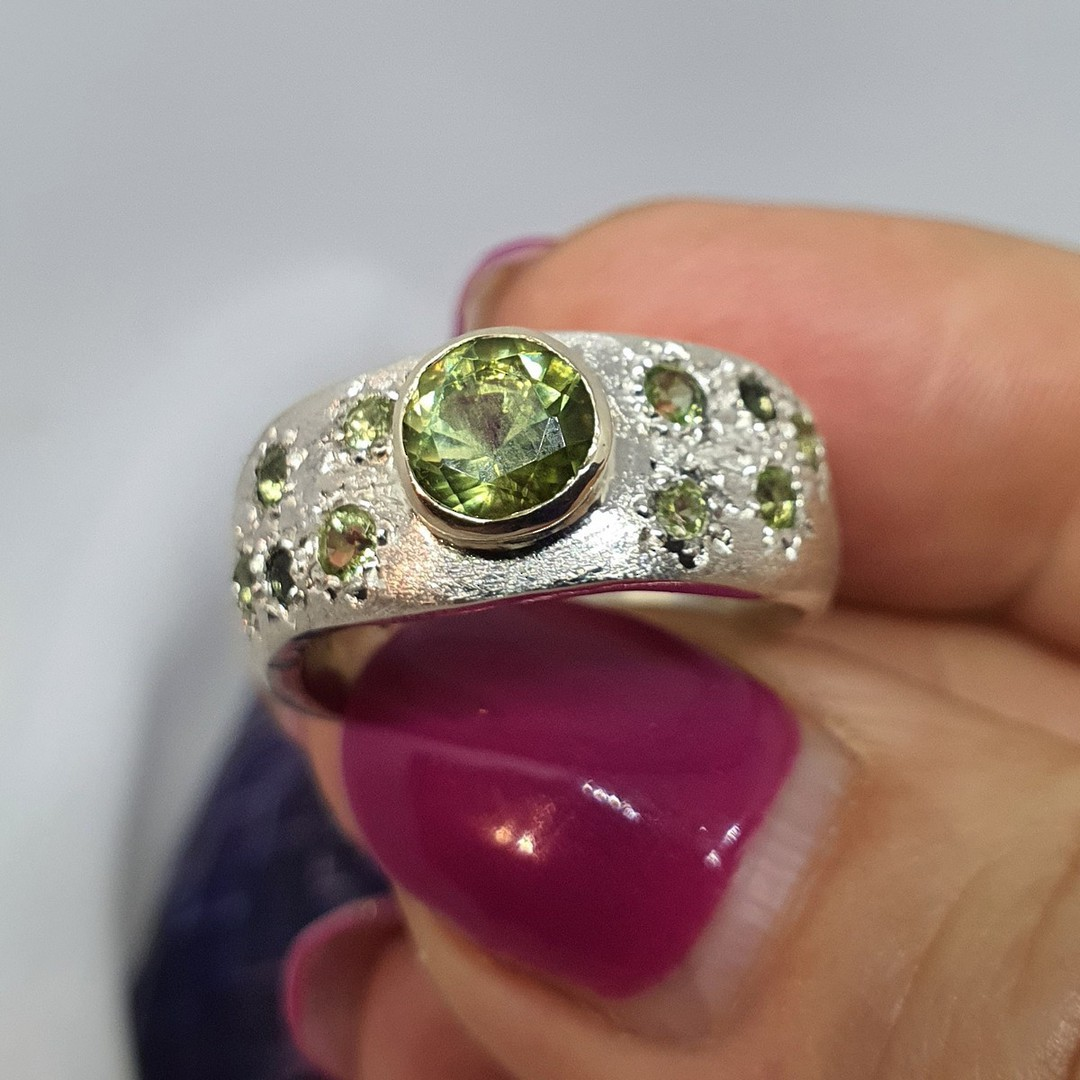Made in NZ. brushed silver ring with natural peridot image 2