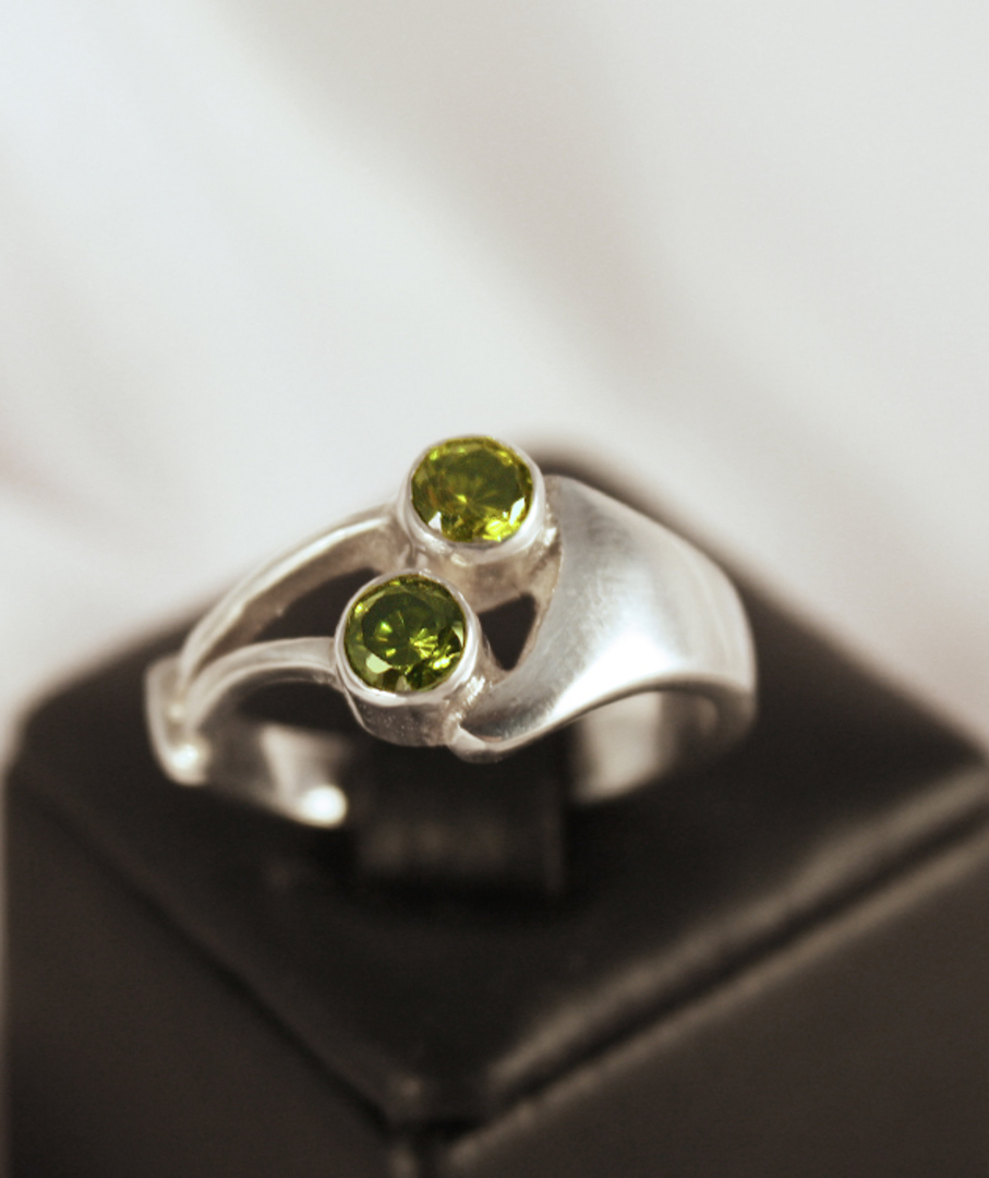Silver synthetic perdiot ring made in NZ image 0