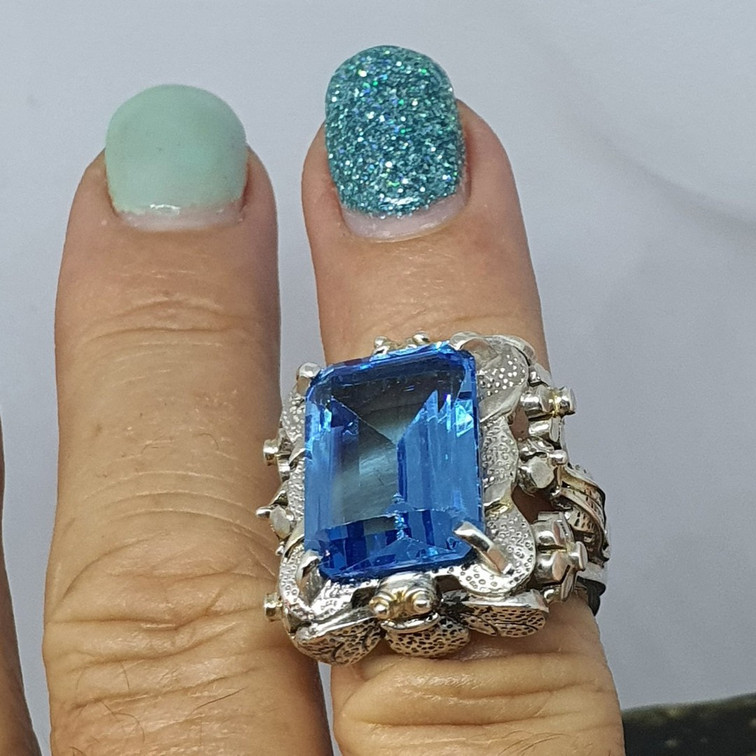 Large chunky silver ring with sparkling blue gemstone image 2