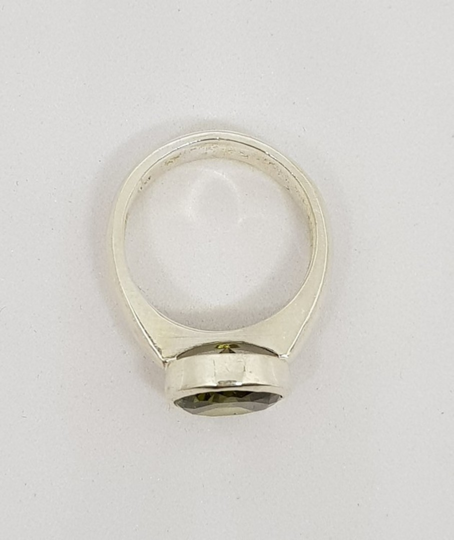 Silver synthetic perdiot ring image 1