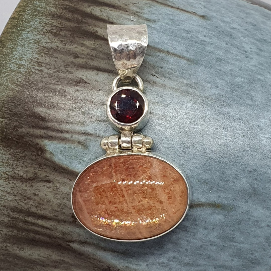 Sterling silver sunstone and garnet pendant image 0