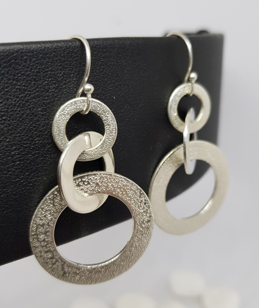 Silver hoop earrings with hammered detail image 1