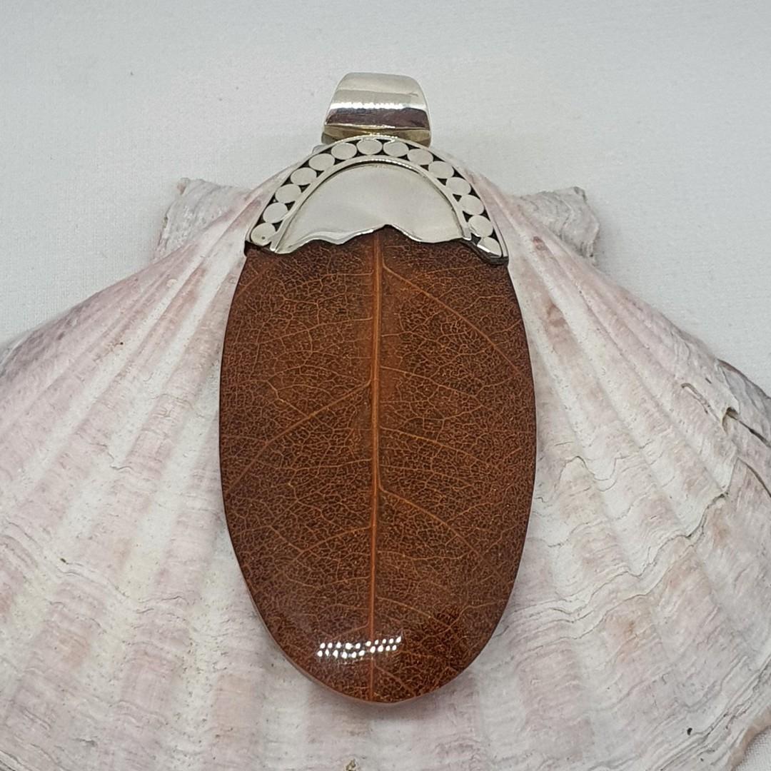 Brown skeleton leaf pendant with silver detailing image 1