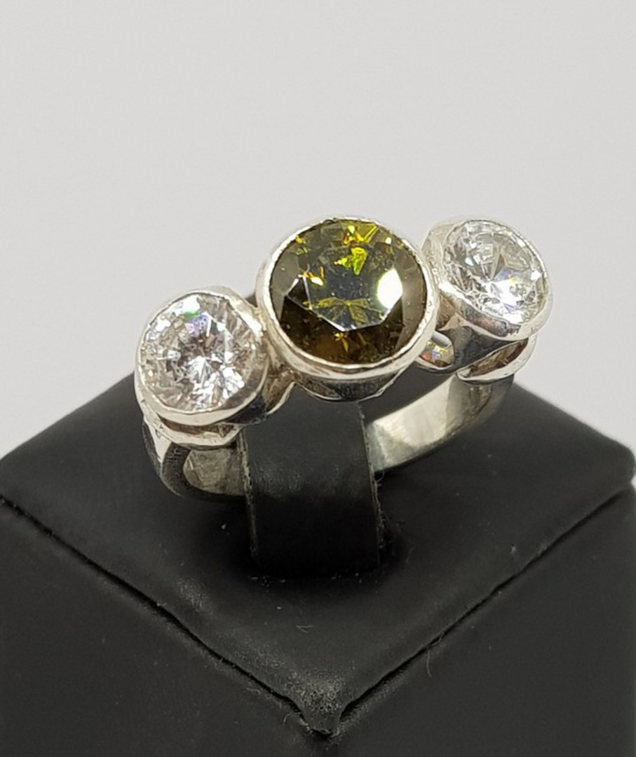 Silver synthetic perdiot ring with two cz image 0
