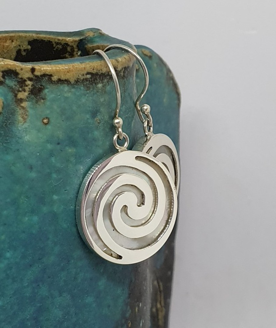 Round mother of pearl earrings overlaid with koru spirals image 1