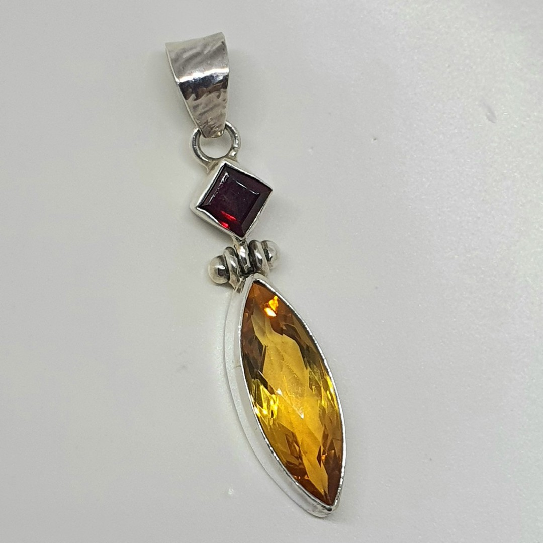 Elegant pendant with yellow and red gemstones image 1