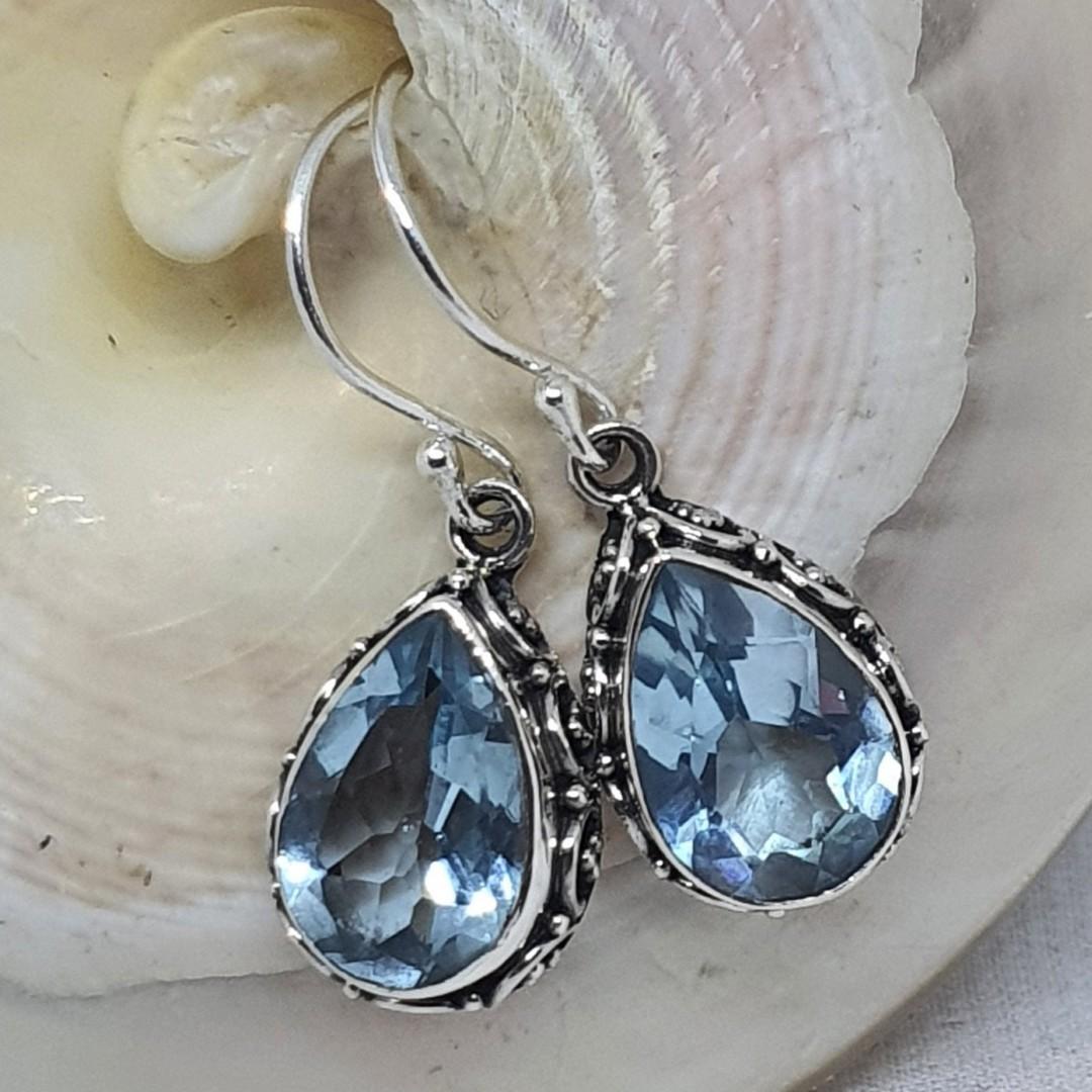 Dazzling blue topaz teardrop silver hook earrings image 1