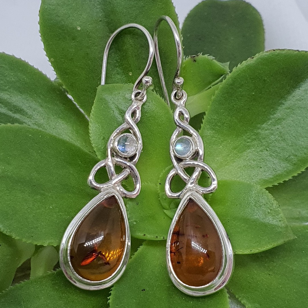 Silver amber earrings with infinity knot and moonstone image 2