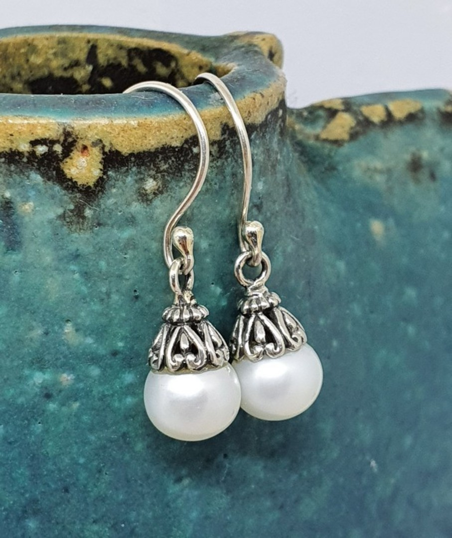 Classic pearl drop earrings with silver detail image 0