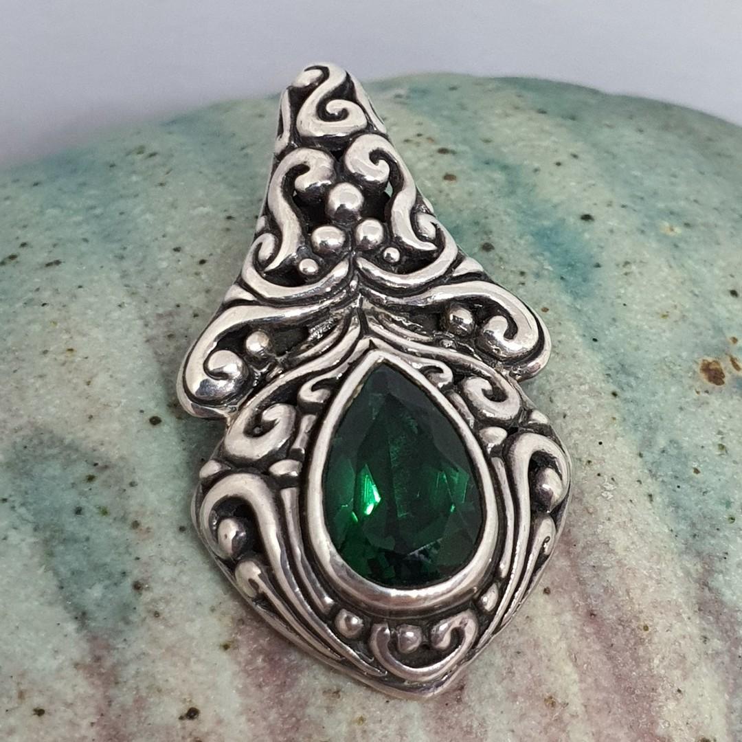 Green quartz pendant set in heavy decorated silver image 0