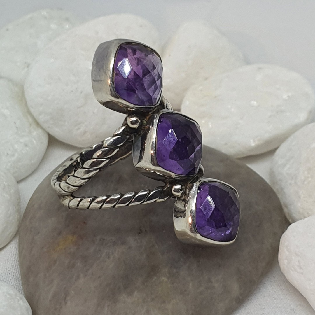 Sterling silver ring with three facet cut amethyst gems image 0
