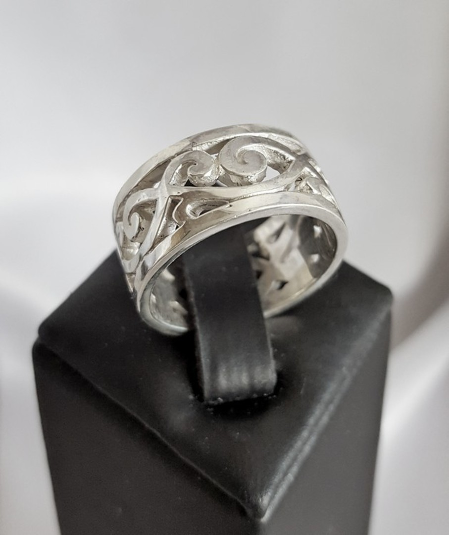 Sterling silver wide band with carved koru designs image 1