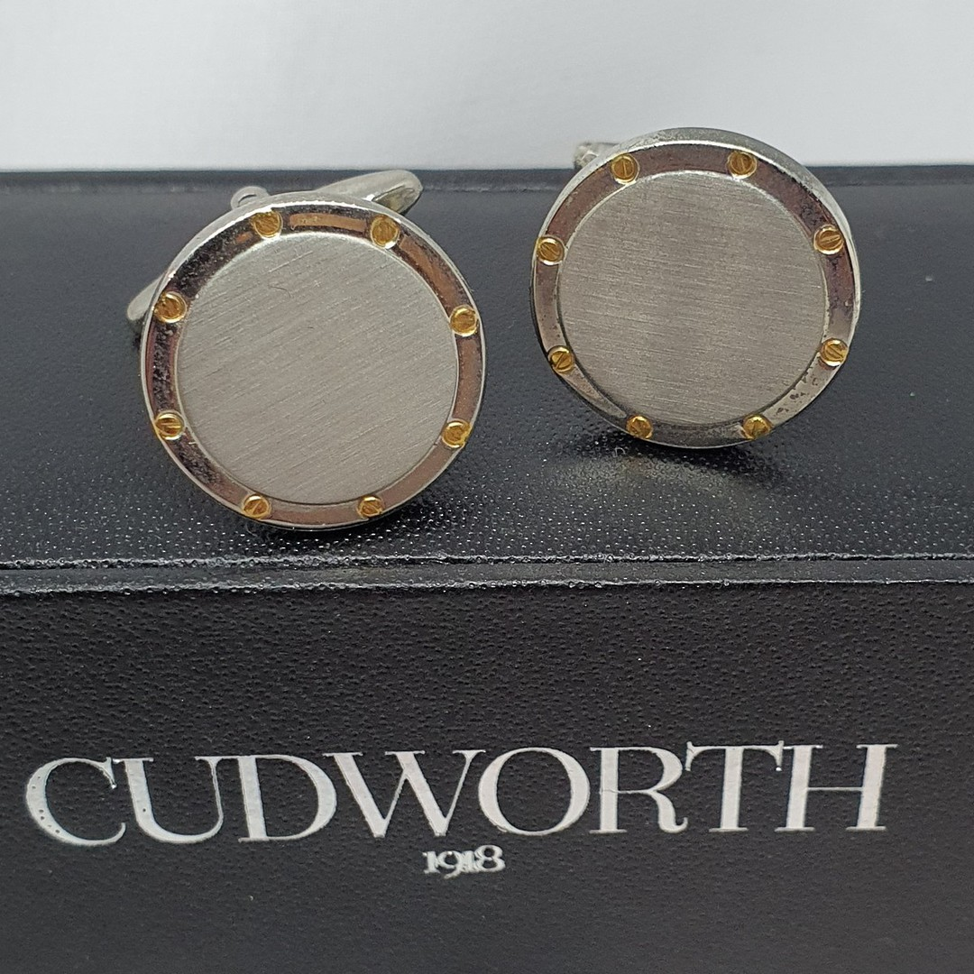 Round silver tone cufflinks with gold flecks image 1