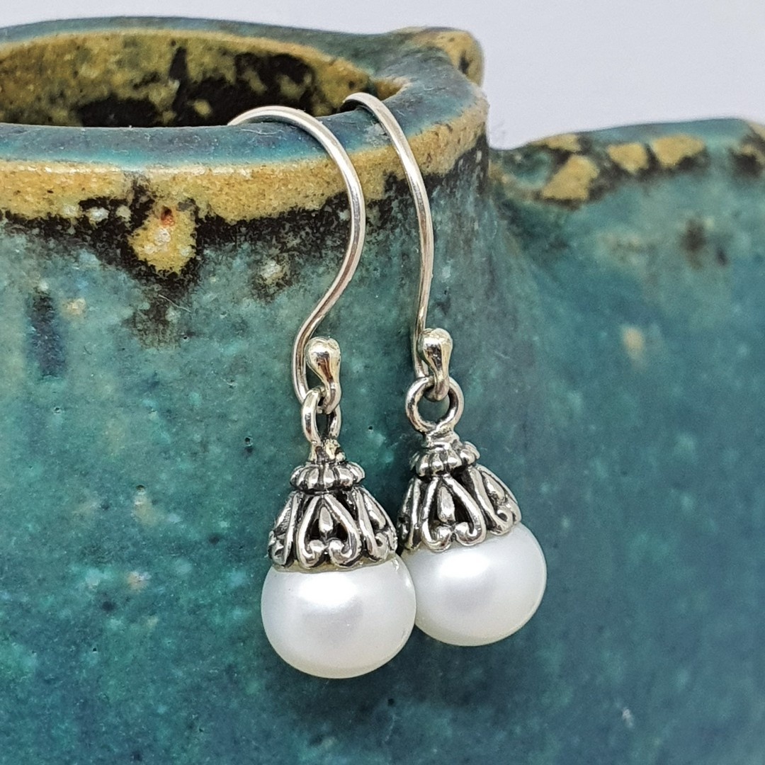 Classic pearl drop earrings with silver detail image 1