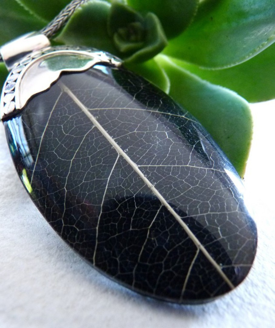 Black skeleton leaf pendant with silver detailing image 2