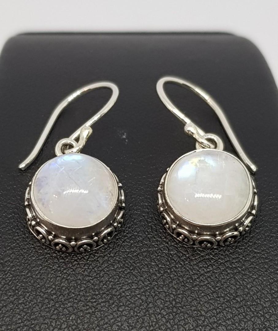 Circular silver moonstone earrings with filigree detailing image 2