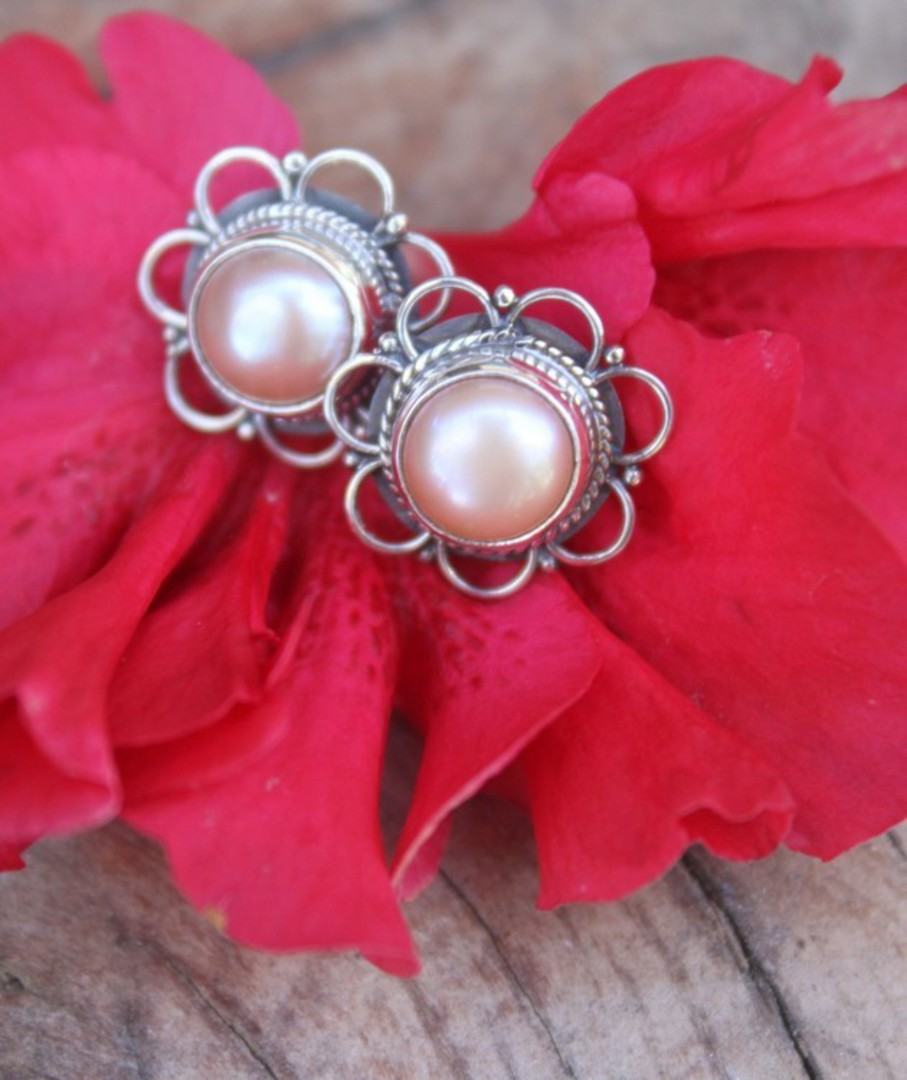White pearl stud earrings with detailed silver frames image 1