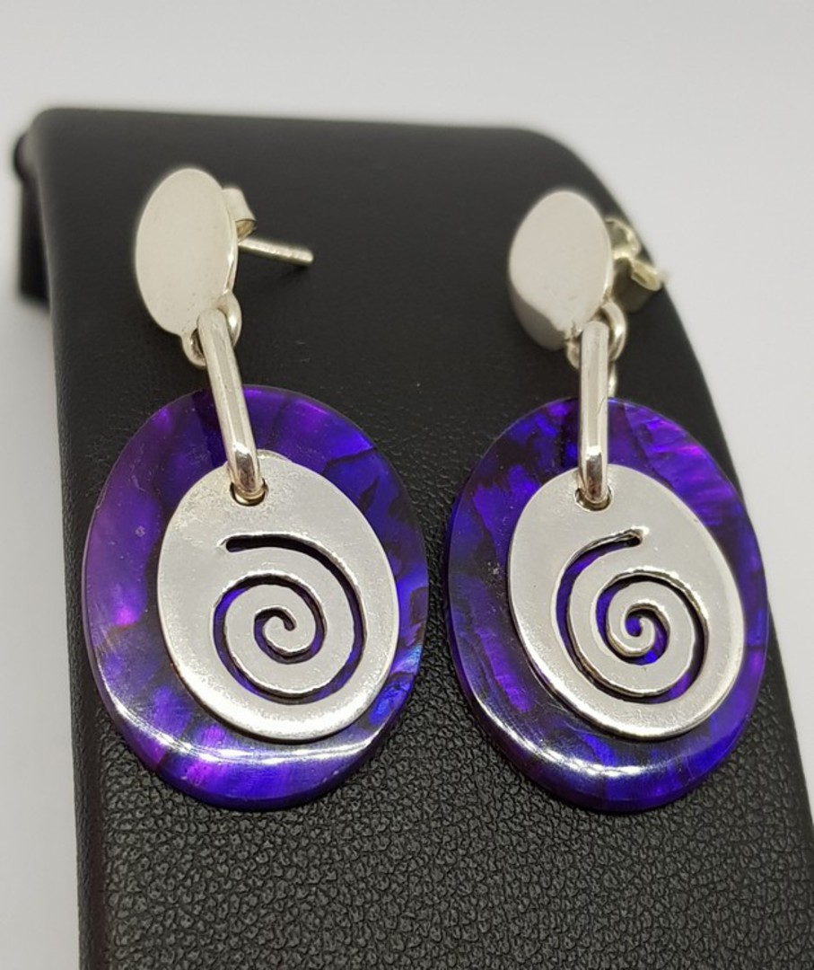 Purple paua shell earrings with silver koru disc image 1