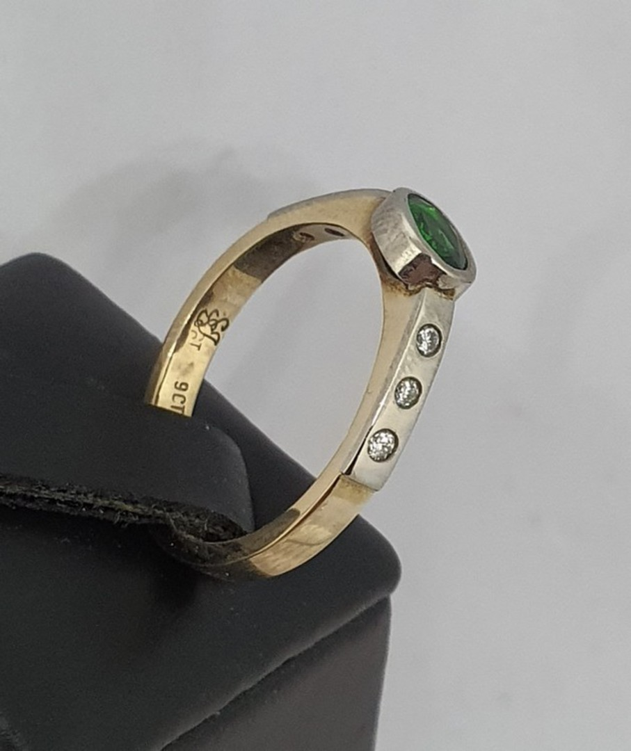 Gold and palladium ring with diamonds and imitation emerald image 1