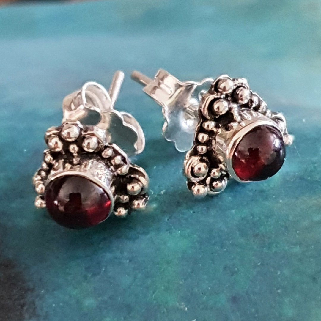 Silver stud earrings with natural garnet image 1