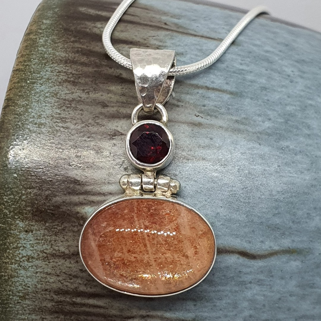 Sterling silver sunstone and garnet pendant image 1