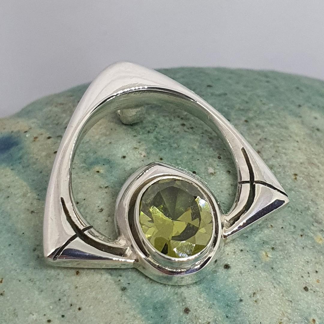 Silver peridot pendant, open triangle image 1
